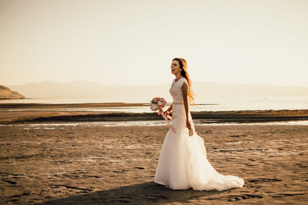 bride gorgeous great salt lake wedding mermaid wedding gown fitted with detailed belt sunset elopement #weddingphotographer #greatsaltlake #elopementwedding #love #married #mermaidweddinggown